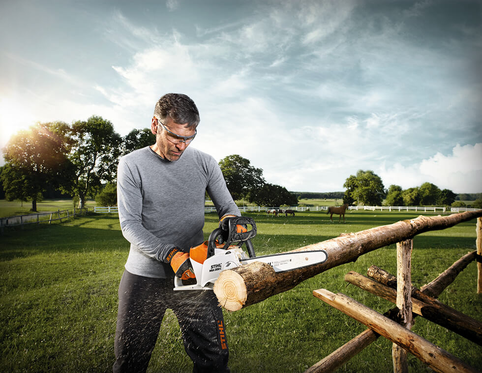 petrol and electric chainsaws at John Miller Garden Machinery shop